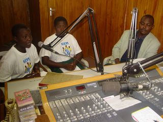 Girls present a radio programme on Girls Education Movement